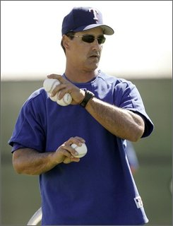 In this March 13, 2007 file photo Texas Rangers third base coach Don Wakamatsu winds up to throw in batting practice at baseball spring training in Surprise, Ariz. Wakamatsu will be named the new manager of the Seattle Mariners. A source familiar with Wakamatsu and the Mariners' search for their 13th full-time manager said Tuesday, Nov. 18, 2008 that Wakamatsu is the choice. (AP Photo/Tony Gutierrez, File)