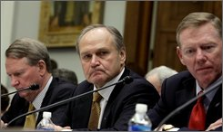 Auto industry executives, from left, General Motors  Chief Executive Officer Richard Wagoner; Chrysler Chief Executive Officer Robert Nardelli; and Ford Chief Executive Officer Alan Mulally, testify on Capitol Hill in Washington, Wednesday, Nov. 19, 2008, before a House Financial Services Committee hearing on the state of the auto industry.  (AP Photo/Evan Vucci)