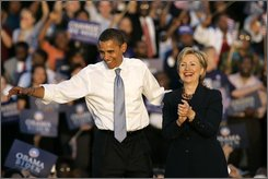 In this Oct. 20, 2008, file photo Democratic presidential candidate Sen. Barack Obama, D-Ill., left, and Sen. Hillary Clinton, D-N.Y. greet supporters at the end of a rally in Orlando, Fla.  Former President Bill Clinton's globe-trotting business deals and fundraising for his foundation sometimes put his activities abroad at odds with Sen. Hillary Rodham Clinton, and it could cause complications for her if President-elect Barack Obama considers her to be secretary of state. (AP Photo/John Raoux, File)