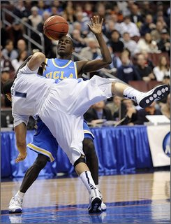 The ball bounces away as UCLA's Darren Collison (2) and Villanova's Scottie Reynolds (1) collide in the first half of a second-round men's NCAA college basketball tournament game in Philadelphia, Saturday, March 21, 2009.  (AP Photo/Michael Perez)
