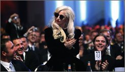 Singer Lady Gaga, receives acknowledgment from U.S. President Barack Obama, as he speaks at the Human Rights Campaign national dinner, Saturday, Oct. 10, 2009, in Washington. (AP Photo/Manuel Balce Ceneta)