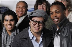 """American Idol"" contestants Joe Munoz, far left, Michael Lynche, top left,  Andrew Garcia, center, Tyler Grady, top center, and Todrick Hall, far right, pose together before the American Idol Top 24 finalist party in West Hollywood, Calif., Thursday, Feb. 18, 2010. (AP Photo/Chris Pizzello)"