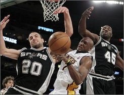 San Antonio Spurs guard Manu Ginobili, left, of Argentina, is defended by Los Angeles Lakers forward Lamar Odom during the first half of an NBA basketball game in Los Angeles on Sunday, April 4, 2010. At right is San Antonio Spurs forward DeJuan Blair. (AP Photo/Jae C. Hong)