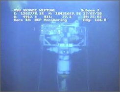 In this image taken from video provided by BP PLC at 3:25 p.m. EDT, the containment stack is shown at the site of the Deepwater Horizon oil spill in the Gulf of Mexico Saturday, July 17, 2010. BP's 48-hour trial run of a cap blocking oil from streaming into the Gulf of Mexico has ended with no word on what happens next. BP spokesman Daren Beaudo said Saturday afternoon the company would communicate if the trial was stopped. With no word from BP as 3:25 p.m. EDT passed, video footage showed the well was still plugged. (AP Photo/BP PLC) NO SALES