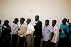 FILE - Southern Sudanese men line up to casts their votes at a polling center in Juba, Southern Sudan, in this Jan. 10, 2011 file photo. The Southern Sudan Referendum Commission said Sunday Jan. 30, 2011 over 99 percent of the people in the south voted for secession in its first official primary results since the vote was held earlier this month. (AP Photo/Pete Muller, File)