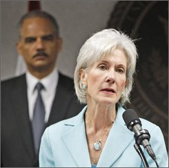 FILE - In this July 16, 2010, file photo Health and Human Services Secretary Kathleen Sebelius, right, talks to reporters during a news conference as Attorney General Eric Holder looks on in Miami, where federal authorities said they were conducting a large Medicare fraud bust in five different states, and arresting dozens of suspects accused in scams totaling $251 million. Medicare and Medicaid scams cost taxpayers more than $60 billion a year, but the average bank holdup is likely to get more attention. (AP Photo/Alan Diaz, File)
