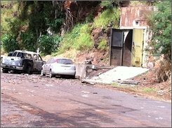 This image provided by KITV shows the entrance to the bunker where fireworks were stored at Waikele Business Center Friday, April 8, 2011 in Waipahu, Hawaii. At least two men were killed, injuring two others and two are missing after the explosion. (AP Photo/KITV)