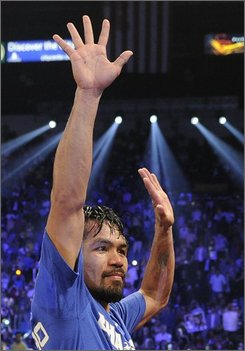 Manny Pacquiao reacts after defeating Shane Mosley by unanimous decision during a WBO welterweight title bout, Saturday, May 7, 2011, in Las Vegas.  (AP Photo/Mark Terrill)