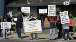 Members of the Calvary Bible Church of Milpitas appear at the closed Family Radio station offices of Harold Camping to offer support to victims of the radio evangelist, who claimed that the ascension into heaven of the Christian faithful would happen today, Saturday, May 21, 2011 in Oakland, Calif.. (AP Photo/Dino Vournas)