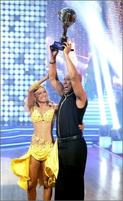"In this publicity image released by ABC, Kim Johnson and Hines Ward pose with their trophy's after scores from the judges were combined with the audience votes to name Hines Ward and Kym Johnson champions of ""Dancing with the Stars"" and winners of the coveted mirror ball trophy, Tuesday May 24, 2011. (AP Photo/ABC, Adam Taylor)"