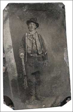 This photograph provided by Old West Show and Auction shows a photograph of a tintype of Billy the Kid taken in 1879 or 1880 in Fort Sumner, N.M. It shows the outlaw standing with his hand resting on a Winchester rifle on one side and a Colt revolver holstered on his right side. The tintype is to be auctioned in Denver on Saturday night and expected to bring between $300,000 to $400,000. (AP Photo/Old West Show and Auction)