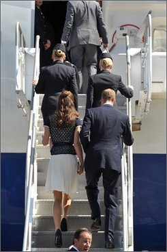 Prince William and Kate, the Duke and Duchess of Cambridge, prepare for their departure at Los Angeles International Airport on Sunday, July 10, 2011, in Los Angeles. Following a nonstop weekend that included a few chukkas of polo, time with Hollywood?s own version of royalty and several events that raised millions for charity, Prince William and his wife, Kate, the Duke and Duchess of Cambridge headed back to the U.K. on Sunday. (AP Photo/John Shearer, Pool)