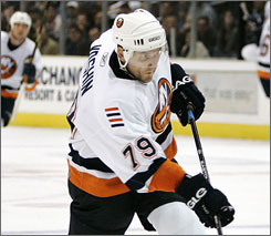 New York Islanders NHL hockey player Alexei Yashin (79) shoots and scores against the Los Angeles Kings in Los Angeles in October 2006. The Islanders plan to pay $17.63 million to buy out the final four years of his 10-year contract.