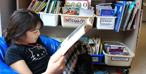 Stephanie Leonor, 10, reads at Moreland Hills Elementary School in Pepper Pike, Ohio.