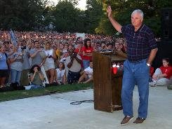 Former Indiana basketball coach Bob knight waves goodbye to students after a rally at the school in Bloomington, Ind., on Sept. 13, 2000. Knight was fired 10 years ago on Sept. 10, 2000.
