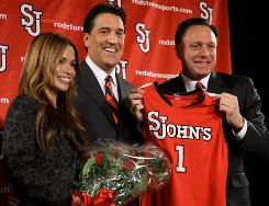 New St. John's head coach Steve Lavin, center, faces several tough tests in his first year at the leader of the Red Storm.