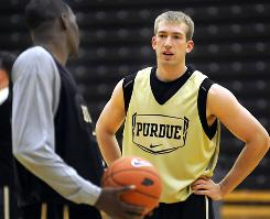 Purdue's Robbie Hummel tore his ACL again during practice on Saturday and will miss the upcoming college basketball season. But the senior's father says he'll come back to Purdue next year.