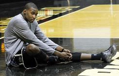Purdue senior JaJuan Johnson stretches during the team's media day on Oct. 21. Johnson has his sights set on becoming one of the Big Ten's best players this season.