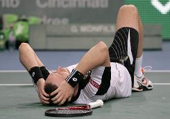 Robin Soderling celebrates after winning the Paris Masters with his straight-set triumph over Gael Monfils.
