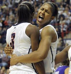 Maya Moore, right, and the Connecticut Huskies put their 79-game win streak on the line when they face No. 2 Baylor Tuesday in Hartford.