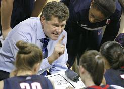 Connecticut coach Geno Auriemma talks to players during a time out against Georgia Tech, a game the Huskies won 71-51 for their 81st consecutive victory.