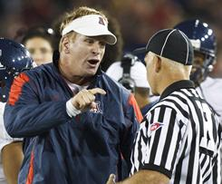Arizona coach Mike Stoops yells at an official during his team's game vs. Stanford on Nov. 6. Stoops' behavior, including his outburst on the sidelines during Arizona's game vs. Oregon last Friday, has shone a negative light on several coaches this season.