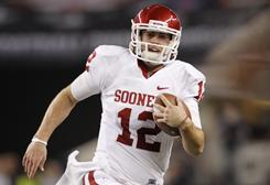 Landry Jones and Oklahoma won the Big 12 to earn the league's automatic BCS bid, which will see the Sooners head to the Fiesta Bowl where they will face Connecticut.