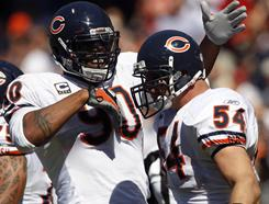 Julius Peppers, Brian Urlacher and the Chicago Bears will try to tame the high-powered offense of the New England Patriots in one of the 12 games that matter most as we wind down the NFL's regular season.