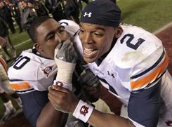 Auburn's Cam Newton and Nick Fairley were named to the AP All-America team Tuesday, along with Oregon running back LaMichael James. Auburn is one of five teams with two players on the first team.