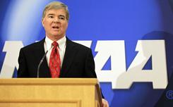 NCAA president Mark Emmert speaks during a news conference earlier this year. During a dinner with reporters Tuesday, Emmert said that the NCAA can not get to a place where athletes are paid for playing at the collegiate level.