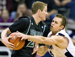 BYU guard Jackson Emery tries to steal the ball from Hawaii's Bo Barnes during their game on Dec. 4. Emery needs just four steals to break the school record set by Danny Ainge 30 years ago.