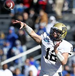 Pittsburgh quarterback Tino Sunseri tosses a pass during the Panthers' 27-10 victory over Kentucky at the BBVA Compass Bowl in Birmingham.