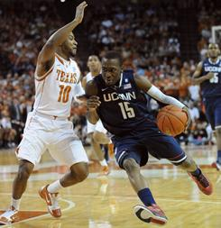 Connecticut's Kemba Walker drives against Texas' Jai Lucas during the ninth-ranked Huskies' road victory over the No. 12 Longhorns.