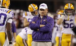 Les Miles says he'll meet with Michigan officials Tuesday about the Wolverines' head coaching position.