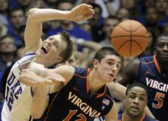 Duke's Kyle Singler, left, and Virginia's Joe Harris reach for a rebound during the second half the Blue Devils' victory in Durham, N.C., on Saturday.