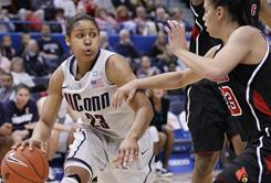Connecticut's Maya Moore drives on Louisville's Shoni Schimmel during their matchup in Hartford, Conn. Moore and the No. 2 Huskies won 78-55 for their 71st consecutive home victory.
