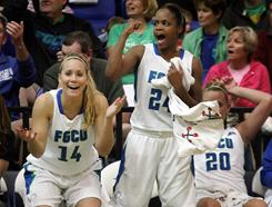 Florida Gulf Coast's Larrin Cook, left, and Eglah Griffin celebrate after a teammate's successful three-point shot during a game against Mercer on Monday.