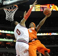 Syracuse's C.J. Fair shoots against Louisville's George Goode during the first half of their Big East matchup Saturday in Louisville.