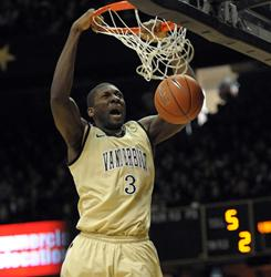Vanderbilt's Festus Ezeli dunks the ball during the Commodores' 71-67 victory over No. 18 Kentucky.