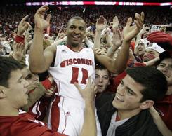 Wisconsin's Jordan Taylor celebrates with fans after the No. 14 Badgers took down top-ranked Ohio State 71-67 in Madison, Wis.