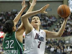 Connecticut's Stefanie Dolson shoots over Notre Dame's Becca Bruszewski during the Huskies' victory on Saturday.