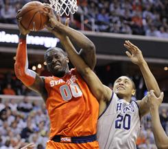 Syracuse's Rick Jackson grabs a rebound from Georgetown's Jerrelle Benimon during the first half of the Orange's victory over the Hoyas in Washington.