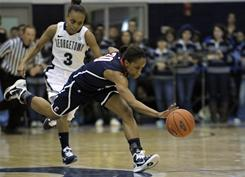 Connecticut's Lorin Dixon scrambles for a loose balll as Georgetown's Rubylee Wright gives chase during the No. 1 Huskies' win in Washington.