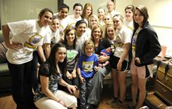 Members of the Lipan High School Lady Indians basketball team pose with head coach Amber Branson and her newborn daughter, Leslie, in Branson's hospital room at Abilene Regional Medical Center.