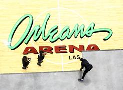 A birds-eye view of an arena work crew converting the Orleans Arena in Las Vegas into a basketball court for the West Coast Conference tournament this week. The Western Athletic Conference will also use the Orleans Arena for its league tournament next week.