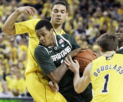 Michigan's Colton Christian, rear, and Stu Douglas surround Michigan State's Keith Appling during the Wolverines' victory Saturday in Ann Arbor, Mich.