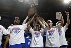 Indiana State players celebrate with the championship trophy after defeating Missouri State to win the Missouri Valley Conference championship and a berth in the NCAA tournament.