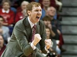 Arkansas is investigating whether basketball coach John Pelphrey's contact with two 2012 recruits violated NCAA rules.