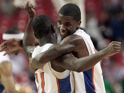 Florida's Kenny Boynton, right, hugs Erving Walker during the Gators victory over Vanderbilt in the SEC semifinals.
