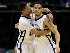 Penn State's Tim Frazier, left, and Talor Battle celebrate during the Nittany Lions' win over Michigan State in the Big Ten semifinals.